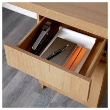 ikea malm desk can be placed in the middle of a room because the back is