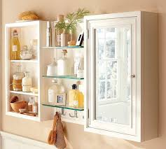 cool design of the bathroom cabinet storage with white wooden materials added with some glass shelves