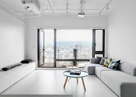 Interior Design For Apartment Living Room Mesmerizing Clean Minimalist Apartment With A Window Overlooking The City