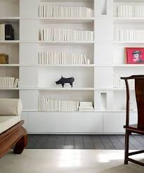 modern built-in bookshelves - if the square sections are cabinets, that's  neat