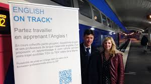 david potier head of commercial relations with france s state rail company promotes the english classes and canadian afton piercy is one of the teachers