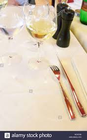 Napkin In Glass Design Silverware Knife And Fork On Linen Table Cloth And Napkin