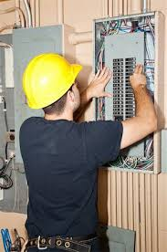electrician fixing fuse box stock photos page 1 masterfile electrician fixing fuse box electrician repairing circuit breakers in industrial electric panel stock photo