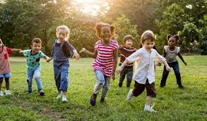 Image result for free images children playing. A multi-racial group of children playing in a field.