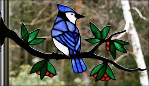 blue jay with berries in stained glass by chippaway art glass