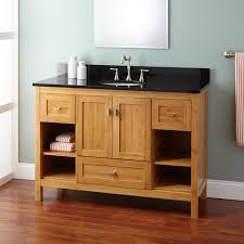 shallow bathroom vanity. light brown stained oak wood narrow bathroom vanity cabinet with rectangle black marble top and single shallow
