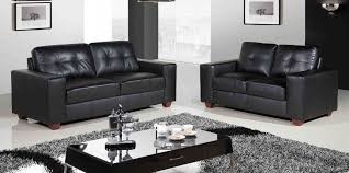 furniture two black leather couch on the white floor combined with rectangle black wooden table