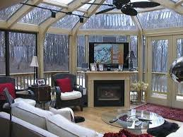 unique sunroom design idea with fireplace and tvset white sectional seating black red area rug glass round coffee table cone ceiling sun room rugs best runs