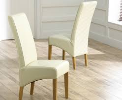 cannes cream bonded leather dining chairs pair
