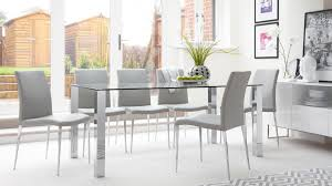 4 6 seater rectangular glass dining table and black dining chairs