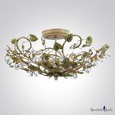 add beautiful focal point with elegant and sophisticated ceiling light fixture adorned by green leaves and crystal beads beautifulhalo com