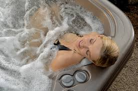 american whirlpool woman in hot tub relaxing