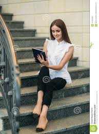 Use Tablet As Phone Young Girl Use A Tablet To Work The Girl In The Cafe Is