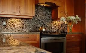 black natural stone kitchen backsplash design with wooden cabinet