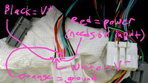 which stock wires to use to connect stock backup camera to cut and connect the red power wire to the output side of a 12v>6v converter this supplies 6v to the backup camera