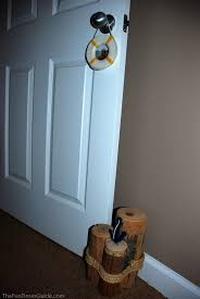 using decorative tree stumps as a doorstopper photo by lynnette at thefuntimesguide com