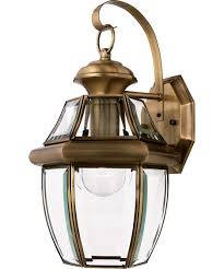 shown in antique brass finish and clear beveled glass