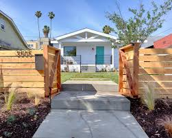 wood fence and gate and white exterior