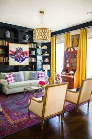 colorful living rooms. Dark Wood Bookcases And Trim, Abstract Artwork, Asian Influenced Jars, Animal Spot Pillows, Bold Colors Overdyed Traditional Persian Rug Colorful Living Rooms L