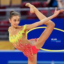 bulgarian born anna stoyanova nor trains with the hoop at the 2018 rhythmic