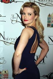 holly madison goes glam with 50s style hair and make up