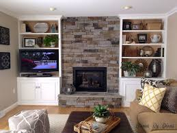 stone veneer fireplace and bookcases