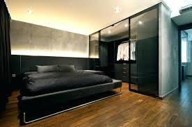 closet behind bed urban bedroom with gray walls and dark hardwood floors a walk in ideas