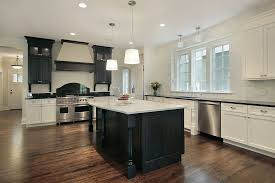 custom black kitchen cabinets. White Kitchen With Extensive Foot Print. Main Cabinets And Dark Counter Tops Wrap Around The Black Island Top. Custom Wall-mounted