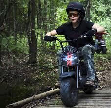 moto bike. classic mini bike - boy riding over bridge moto e