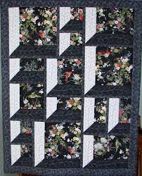 Quilt Inspiration: Into, Through, and Beyond : Attic Windows Quilts & Alice Kay Arnett of Wyoming uses the cool hues hues of white and charcoal  gray fabric on her window frames. These wintry tones give the impression of  ... Adamdwight.com