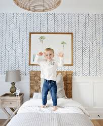 Pretty kids room with blue herringbone wall paper #kidsroom  #kidsbedroomideas #blueinspiration Find more
