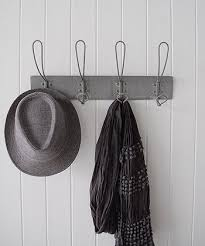 grey coat rack with 5 looped hooks for hanging coats in hall or towels in  bathroom