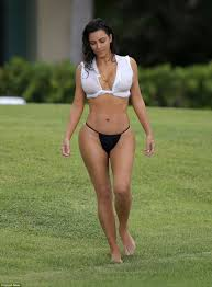 Kim Kardashian s breasts on show in see through bikini top in.