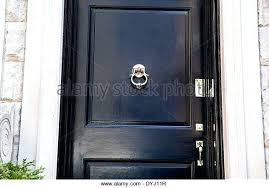 black front door hardware. Black Front Door Handle Shiny Lacquered Entry Featuring A Finely Polished Brass Lock . Hardware