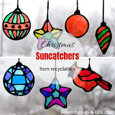 make stained glass suncatchers from recyclables with kids this winter craft comes with four
