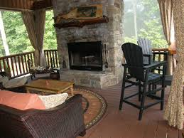 fireplace deck with deep seating and bar height chairs for viewing