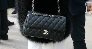 editorial milan woman with black leather chanel bag and fur coat before giorgio armani fashion show milan fashion week street style on february 27