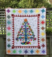 Wendy's quilts and more: Oh Christmas Tree & I've spent the last two months hand quilting it and I just love the soft  texture it has, due the hand quilting and wool batting. Adamdwight.com