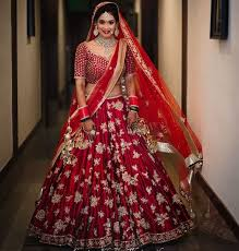 35 punjabi bridal lehenga styles that you would want to steal Wedding Lehenga Price maroon embroidered wedding lehenga collection with price wedding lehenga price in india