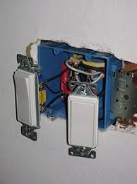 light switch two light switches and wiring as installed in the united states switches are fastened in a non metallic box then a cover plate is installed