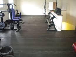 flooring ideas black rolls rubber gym flooring with blue padded sport equipments in minimalist gym