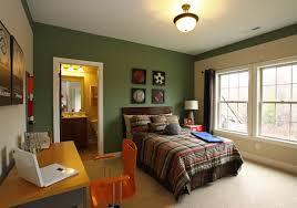 bedroom dark green bedroom wall with orange chair and brown wooden desk plus brown bed