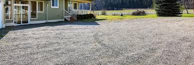 a country house with gravel driveway