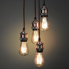 retro lighting. suspend four vintage filament bulbs to create a stunning retro lighting feature with this brushed copper quad pendant read more i