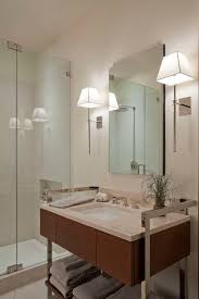 luxury master bathroom using double white shade bathroom sconces between wall mirror and single sink vanityupgrade your bathroom lighting with bathroom
