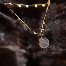 gold necklace with rose quartz pendant