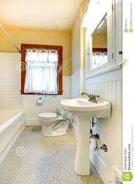 Yellow And White Bathroom With Window Stock Photo Image - Yellow and white bathroom