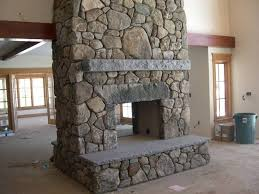 two sided fireplaces with round stone facade yahoo image search results