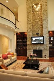 remarkable stone veneer fireplace design with lighting in spacious modern living room
