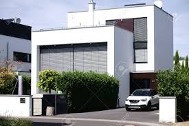 modern residential building. Perfect Building A New And Modern Residential Building With A Garage Lowered Metal  Blinds Banque D And Modern Residential Building